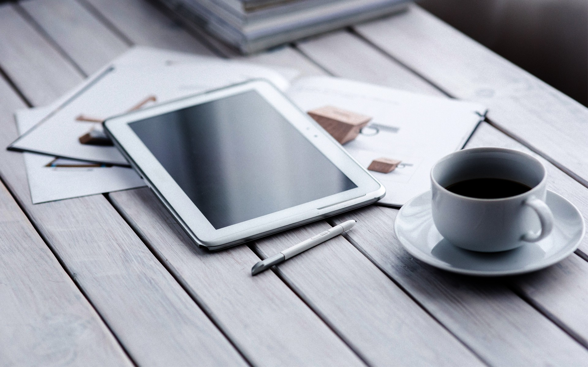A Table With Tablet Stylus Coffee