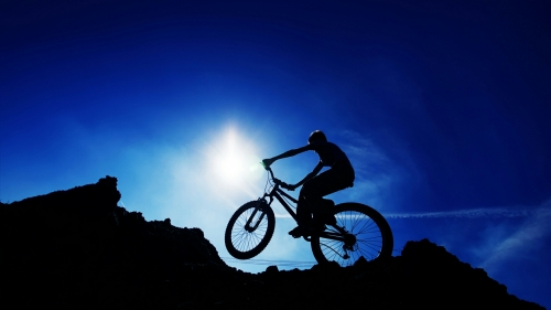 A Bike Rider On A Mountain Sports QHD Wallpaper