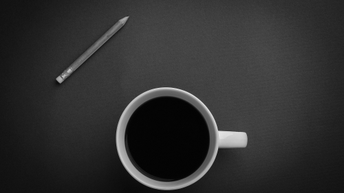A Coffee Cup And A Pencil On Gray Surface