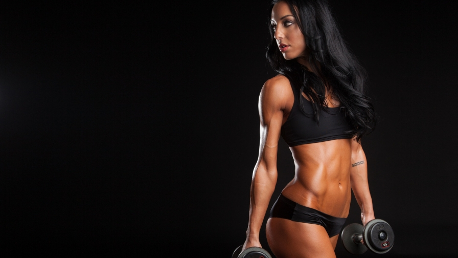 A Fitness Model Wearing Black Posing With Dumbells Health HD Wallaper