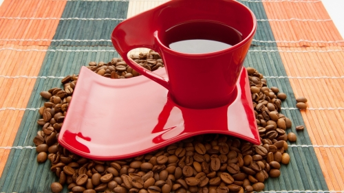 A Red Coffee Cup and Coffee Beans on Tabel Mats QHD Wallpaper