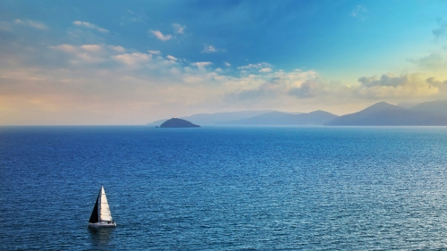 A Sailboat In The Ocean With Clear Blue Sky Nature QHD Wallpaper