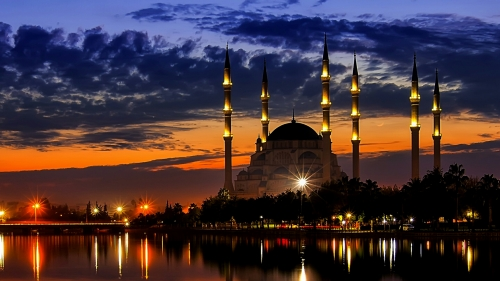 A View Of A Mosque At Dusk CityScape QHD Wallpaper