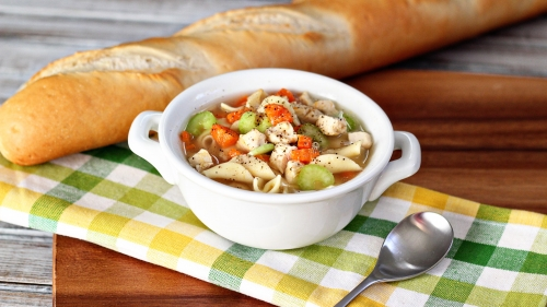 A White Bowl Of Soup Chicken Noodles Carrots Peppers Onion Baguette   4K Food Wallpaper