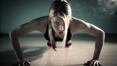 A Woman Doing Pushups In The Gym Health HD Wallpaper
