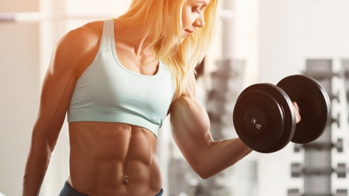 A Woman Lifting Dumbells In The Gym Health HD Wallpaper