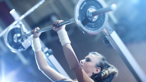 A Woman Lifting Weights Doing Bench Press In The Gym Health HD Wallpaper