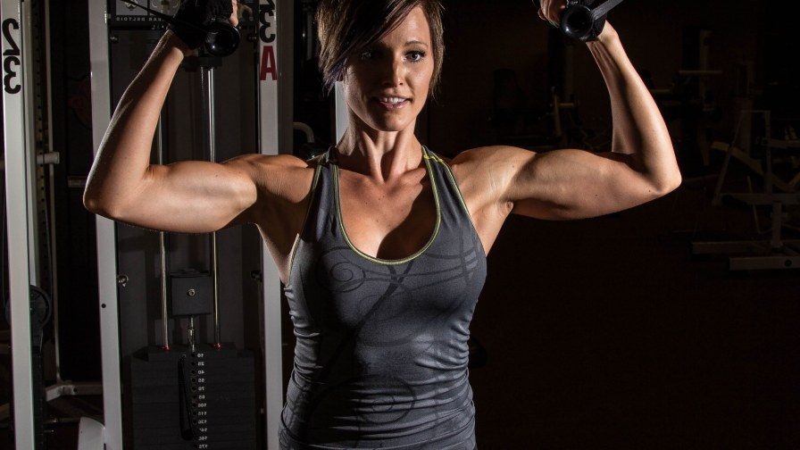 A Woman Working Out In The Gym Health Hd Wallpaper 2 Wallpaper