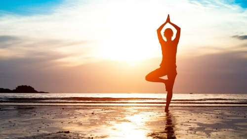 A Yougn Woman Doing Yoga at the Beach Early in the Morning Health UHD Wallpaper