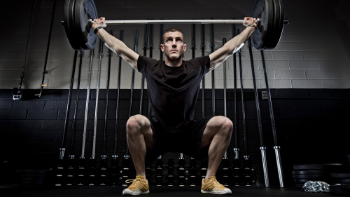 A Young Athletic Man Raises A Heavy Barbells Above His Head During Gym Training Health HD Wallpaper