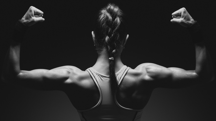 A Young Woman Showing Her Back Muscles Health HD Wallpaper