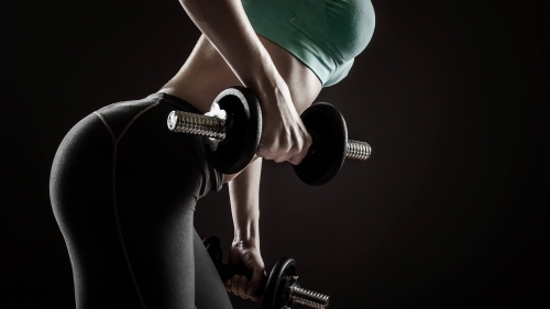 A Young Woman Wearing Green Top And Black Yoga Pants Lifting Dumbells Health HD Wallpaper