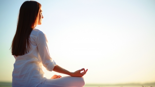 A Young Woman Wearing White Relaxes In Yoga Position At Sunrise Health HD Wallpaper