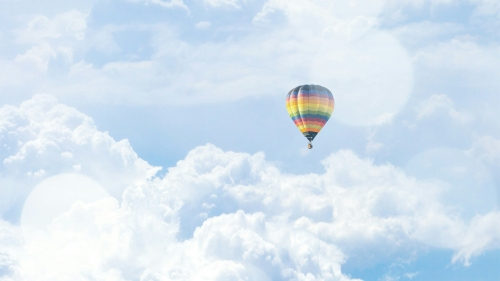 Colorful Hot Air Baloon In The White Clouds Nature QHD Wallpaper