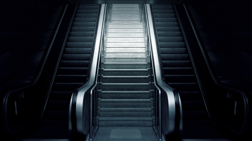 Escalator At A Subway Metro Station And Stairs On The Side