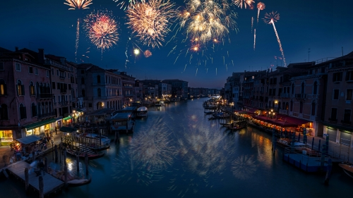Fireworks Over a Sleepy Town Cityscape QHD Wallpaper