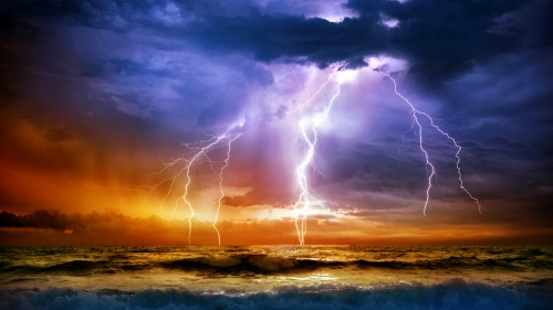 Lightening Strikes The Ocean On A Stormy Night QHD Wallpaper