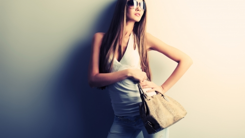 Model Girl Holding a Bag Wearing Sunglasses a Torn Jeans and a White Top UHD Wallpaper