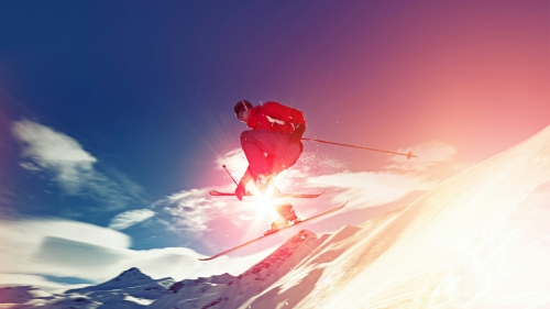 Skiing Over The Snowy Mountains Wearing Red Jacket  Sports QHD Wallpaper